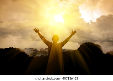 The man thank God on the mountain. - Shutterstock ID 407136463