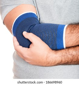 Man with a therapeutic elastic band on his elbow isolated on white