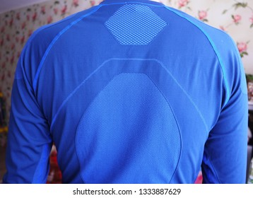 Man thermal underwear, beautiful fabric, fits the body and chest. Details, close-up, daylight.