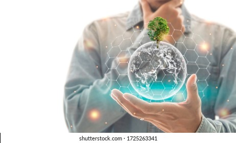 A man is thinking about How to safe the world. Environment and ecology concept