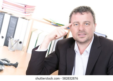 Man thinking about the job at hand on face in business day
