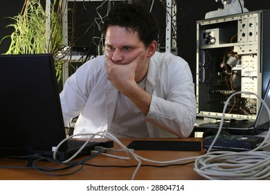 man thinking about problems on computer in the repair plant