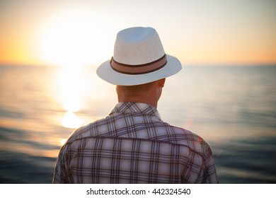 man thinking backlight sunset travel concept beach shallow depth of field filter