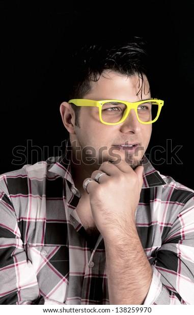 Man thinking on black background