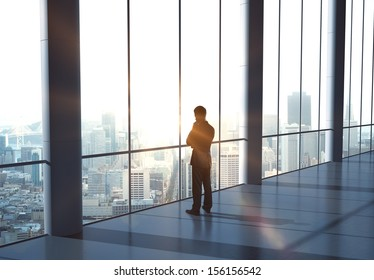 man thinking and standing in office