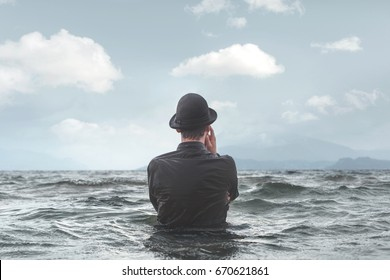 man thinking underwater observing clouds surreal concept