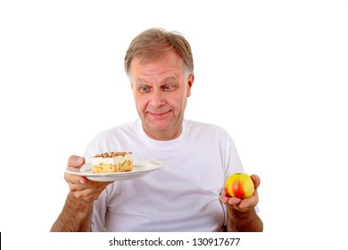 Man thinking what to eat between an apple and a cake