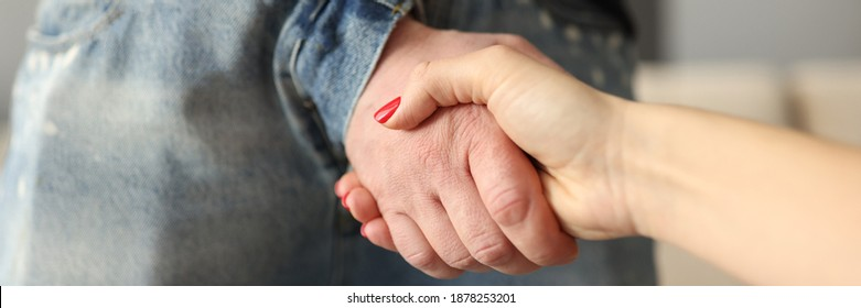 Man through fly on jeans shaking hands with woman close-up. Promiscuous sex concept