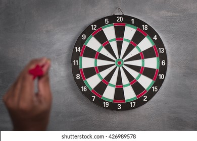 A man throw a Plastic tip Dart ,Target aim symbol of goal , business concept