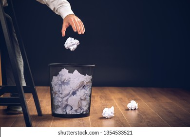 Man Throwing Away Papers into Trash Bin, Inspiration, Creativity and Idea Concept For Business