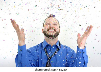 Man throwing confetti into the air.