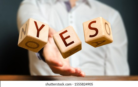 A man throws cubes with letters and makes up the word YES. Agreement and acceptance, answer the question. Courage and irresistibility, zeal forwards, consent. Confirmation and acceptance, approval