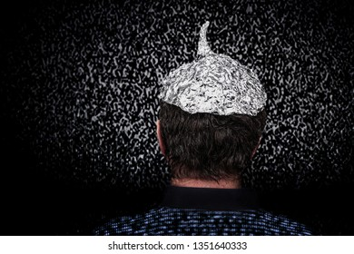 Man in a tin foil hat with digital noise