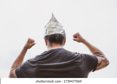 Man with a tin foil hat on his head demonstrate angry, concept conspiracy theory and schwurbler