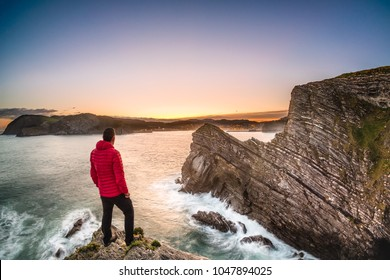 A man at the top of a cliff