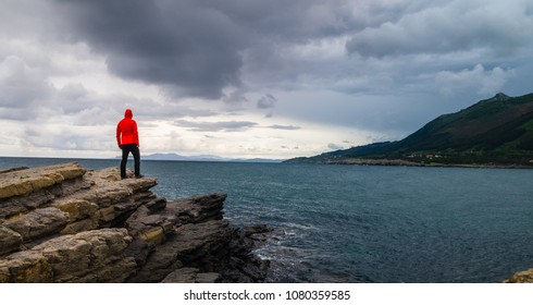A man a the top of a cliff