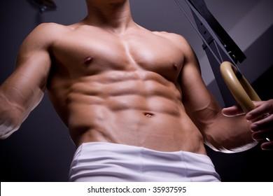Man torso with gymnastic ring