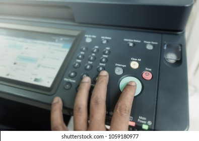 Man touch startup copying paper from Photocopier with access control for scanning in the office business