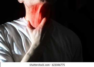 The man touches his sore  throat, neck, Temperature, runny nose, illness,