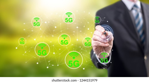 Man touching a 5g concept on a touch screen with a stylus pen
