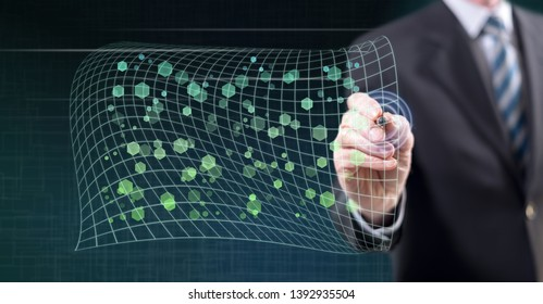 Man touching an abstract network concept on a touch screen with a stylus pen