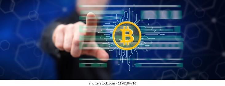 Man touching a bitcoin currency concept on a touch screen with his finger