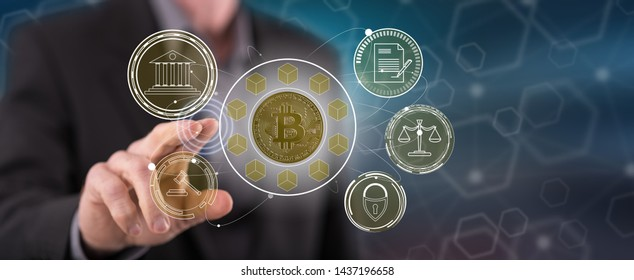 Man touching a bitcoin regulation concept on a touch screen with his finger
