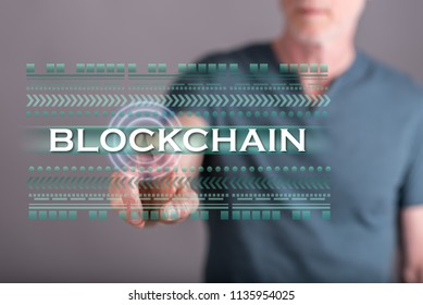 Man touching a blockchain concept on a touch screen with his finger