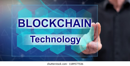 Man touching a blockchain concept on a touch screen with his fingers