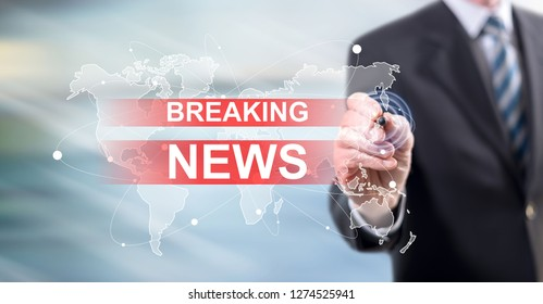 Man touching a breaking news concept on a touch screen with a stylus pen