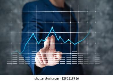 Man touching business charts in screen