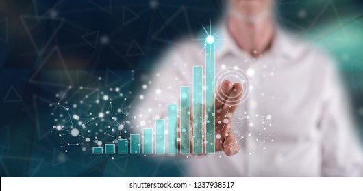 Man touching a business success concept on a touch screen with his finger