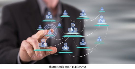 Man touching a businesssocial network on a touch screen with his finger