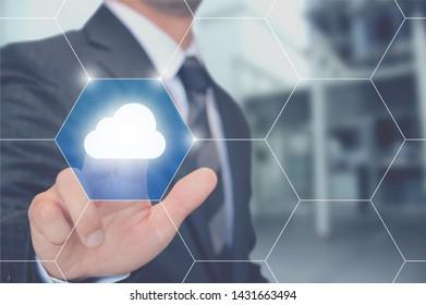 Man touching a cloud button