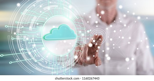 Man touching a cloud computing system concept on a touch screen with his finger