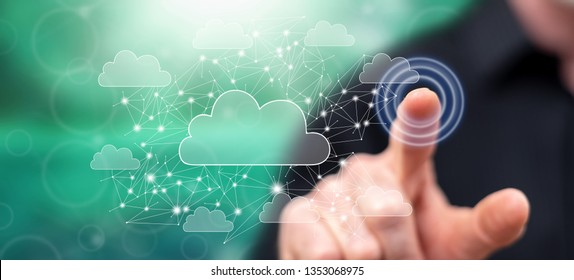 Man touching a cloud networking concept on a touch screen with his finger
