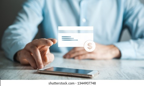 man touching credit card  in phone screen