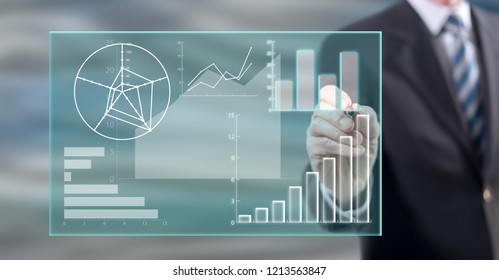 Man touching a data analysis concept on a touch screen with a stylus pen