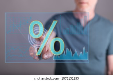 Man touching digital interest rates data on a touch screen with his finger