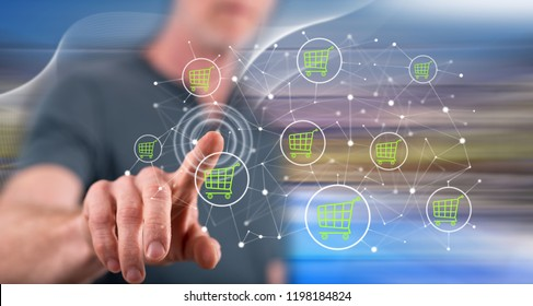 Man touching an e-commerce concept on a touch screen with his finger