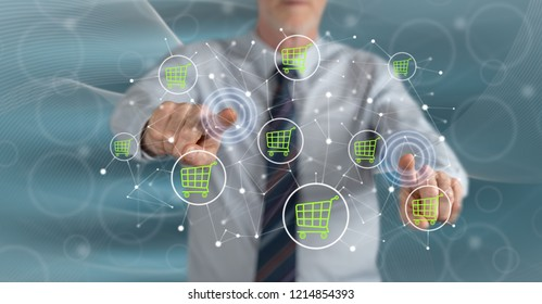 Man touching an e-commerce concept on a touch screen with his fingers