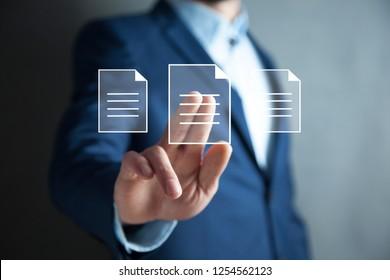 man touching file in screen