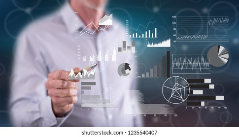 Man touching a financial analysis concept on a touch screen with a pen