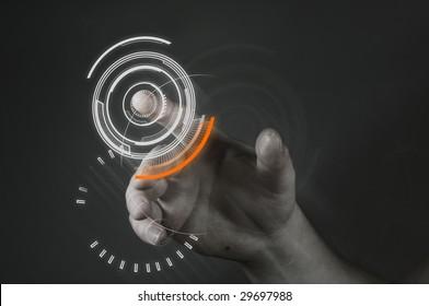 A man touching a futuristic button.