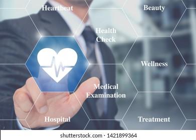 Man Touching health cardiogram button