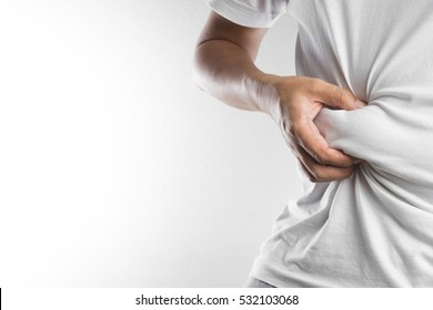 Man touching his fat belly on white background