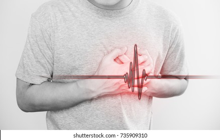 a man touching his heart, with heart pulse sign, concept of heart attack, and others heart disease
