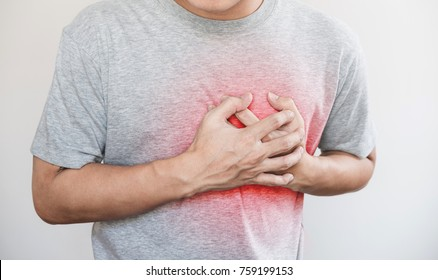 a man touching his heart, with red highlight of heart attack, heart failure and others heart disease