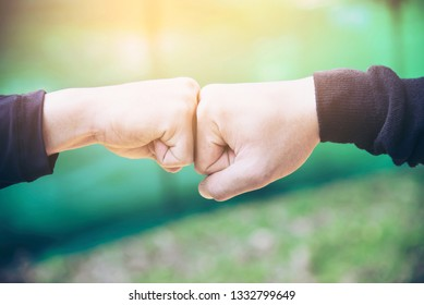 Man touching / holding hand together for success commitment work concept