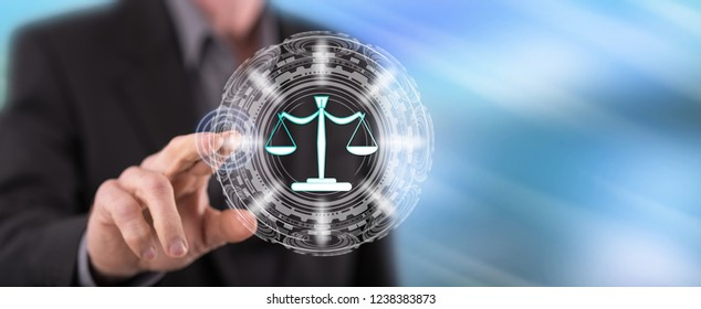 Man touching a justice concept on a touch screen with his finger